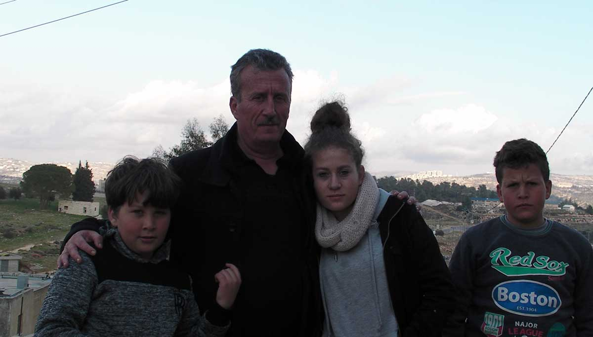 Bassem Tamimi with three of his children. Credit: The Oakland Institute