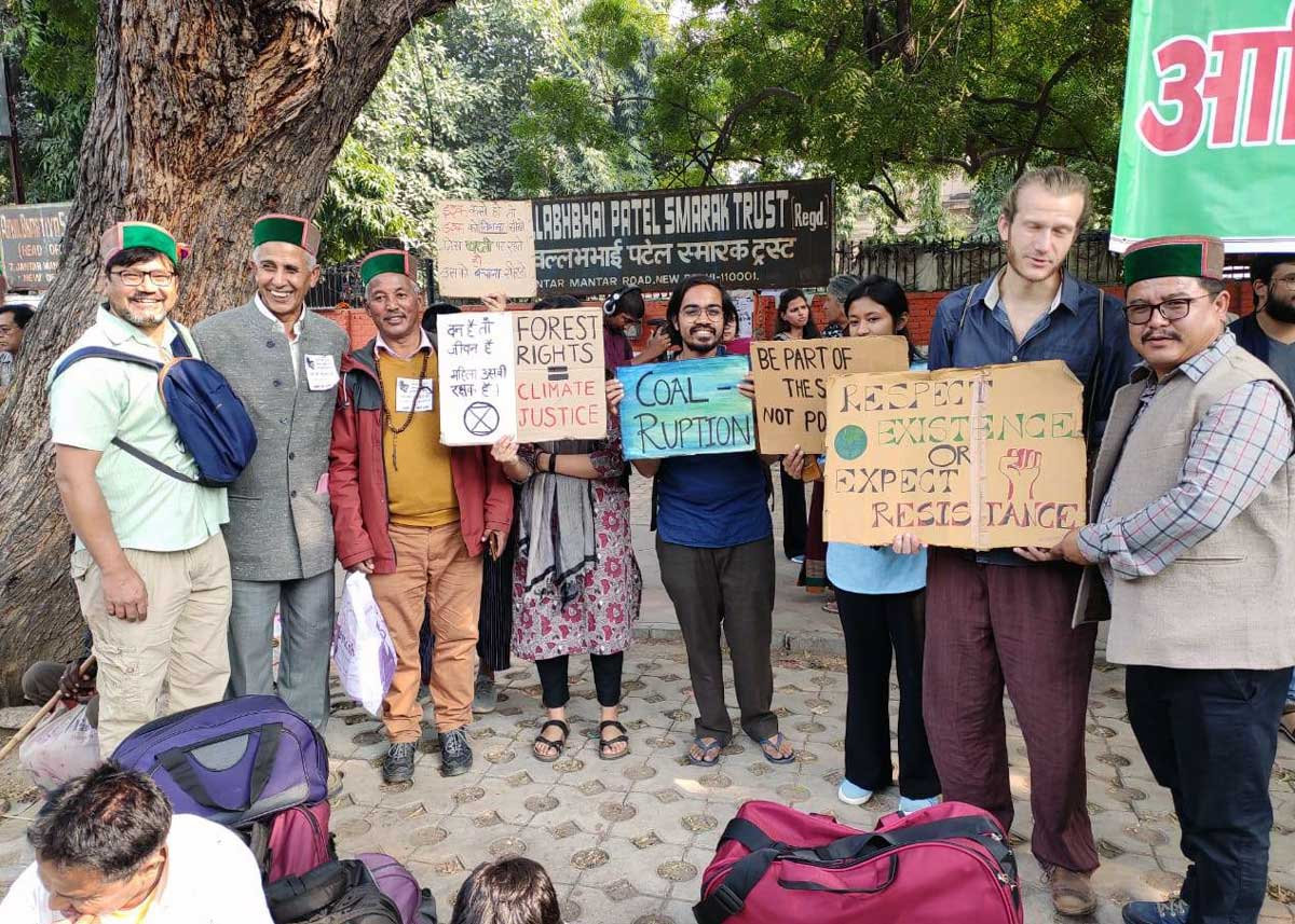 Members of Extinction Rebellion's India Chapter and the Fridays for Future movement stand shoulder to shoulder with <i>Adivasi</i> activists. Credit: Amir Khan/ Delhi Forum and AIUFWP