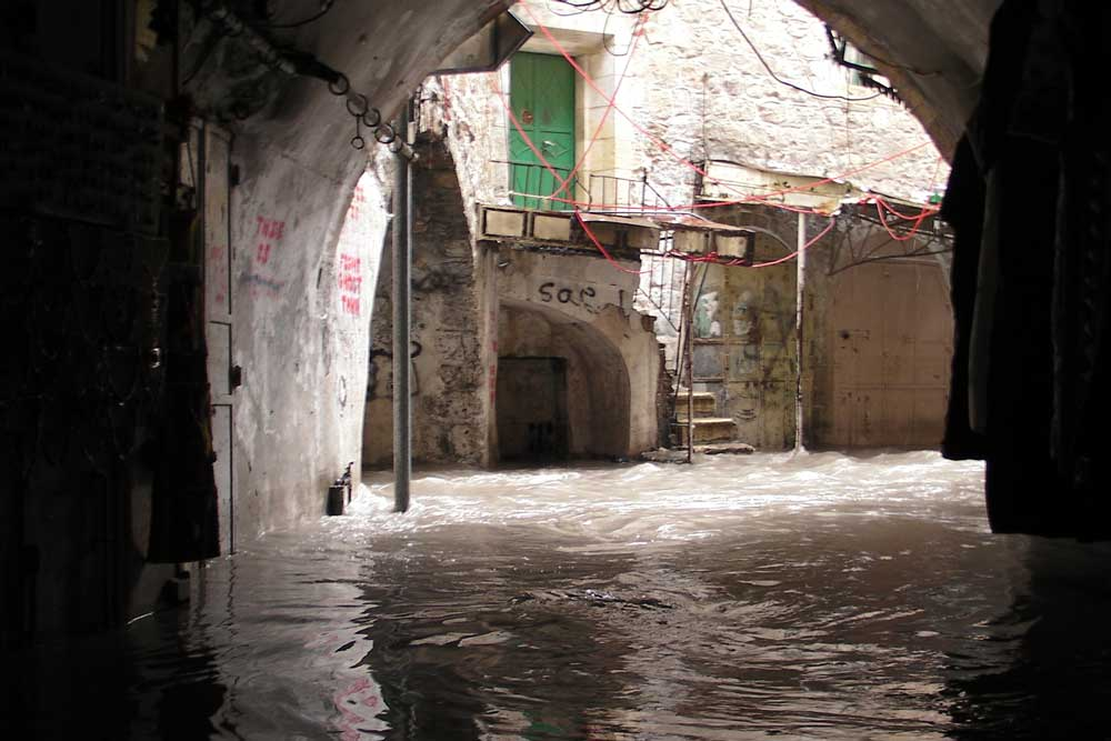 Flooding in the Old City market. Credit: The Oakland Institute