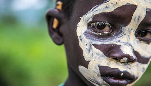 Suri boy with traditional face painting in the Kibish region of the Omo Valley, April 2018. Copyright: Kelly Fogel