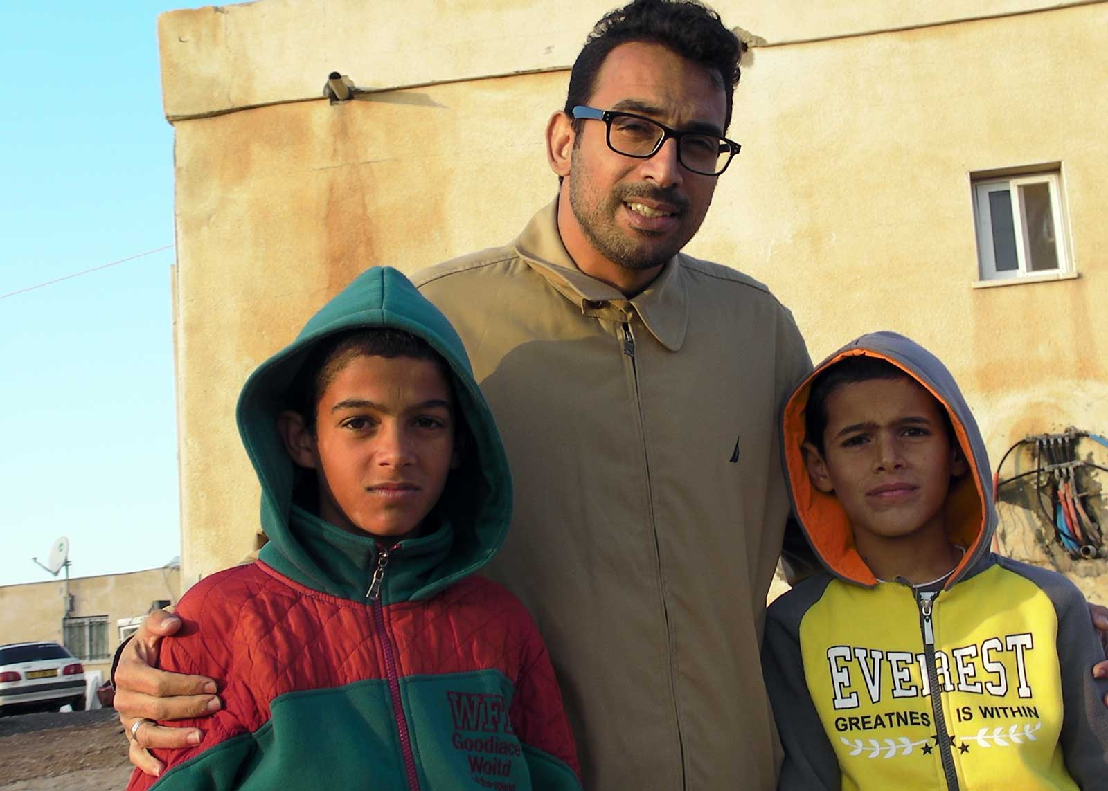 Abo Kweder with two young residents of Umm al-Hiran. Credit: The Oakland Institute