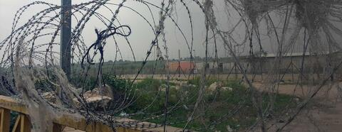 Barbwire to fortress the separation wall in Qalqilya. Credit: The Oakland Institute