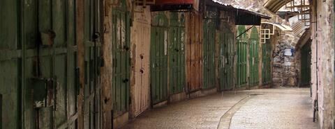 Welded shut doors of shops and homes in the Old City. Credit: The Oakland Institute