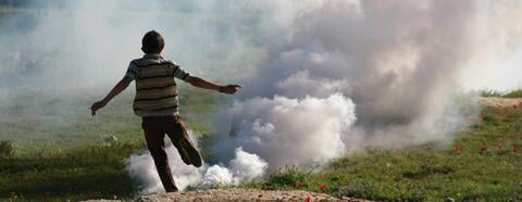 """""""Nabi Saleh Protest"""" Credit: Fred Jennings https://www.flickr.com/photos/simnatic/6971879819. CC BY-NC-SA 2.0, image cropped and resized from original."""