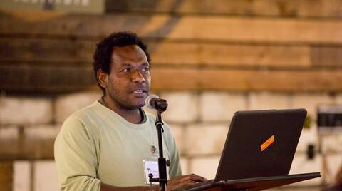 Paul Palosualrea Pavol speaking at an October 2017 Oakland Institute event. Credit: The Oakland Instittue.