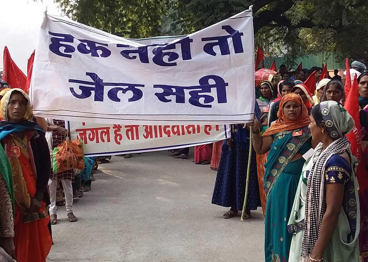 <i>Adivasi</i> women defiantly hold up a banner saying &ldquo;<i>Hak Nahi to Jail Sahi</i>&rdquo;&#8212;announcing their willingness to face imprisonment in the struggle for their forest rights. Credit: The Oakland Institute