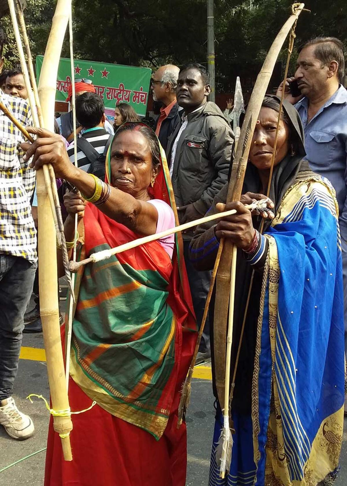 Rajkumari Bhuiya from the Bhuiya Adivasi community in Dhuma village, also from Sonbhadra displaying the traditional bow and arrows her community uses to defend their land from predators. Credit: The Oakland Institute
