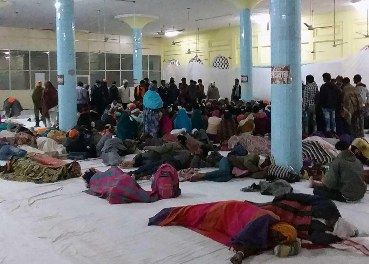 Members of the Jagrit Adivasi Dalit Sangathan resting after their 16 hour journey from Madhya Pradesh at Gurudwara Rakab Ganj Sahib. Credit: The Oakland Institute