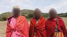 Maasai villagers, their faces are hidden for their protection. Credit: Oakland Institute