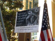 A poster of Olympic silver medallist Feyisa Lilesa at a protest in Oakland, California. Making the crossed arm gesture is now a criminal offense under Ethiopia's state of emergency. Credit: Elizabeth Fraser